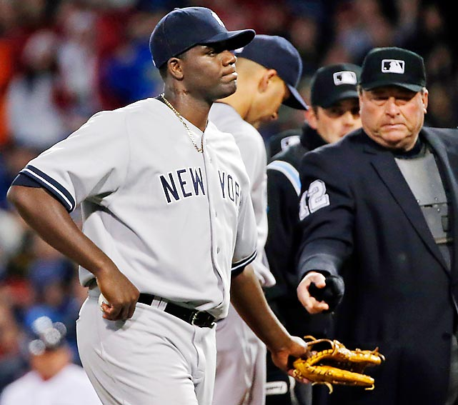 A sticky situation indeed: Home plate umpire Gerry Davis was not amused to find a glop of pine tar on the Yankee hurler's neck. Though Pineda insisted that the foreign substance was merely a manly new aftershave that drives the ladies wild, the unsmiling arbiter ejected the shameless rogue in the second inning of New York's game against the Boston Red Sox at Fenway Park.