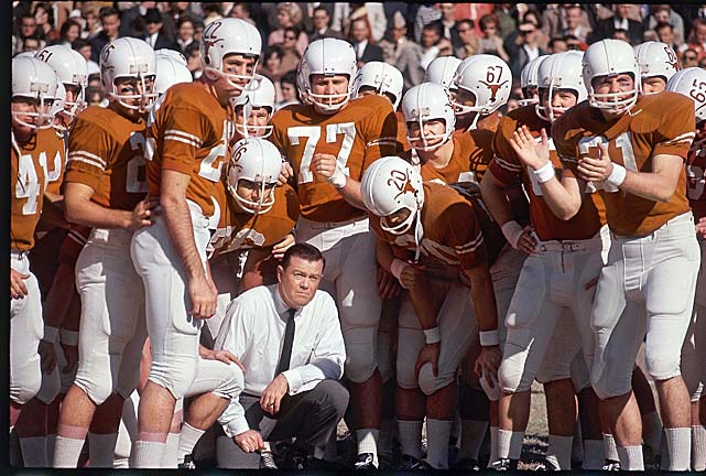 Texas coach Darrell Royal with his team at the 1964 Cotton Bowl. The undefeated Longhorns would move to 10-0 with a win over Navy in the first of two career meetings between the schools.