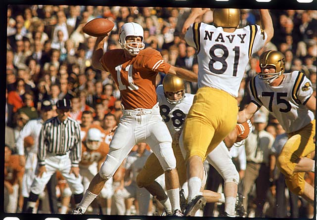 Texas quarterback Duke Carlisle throws under pressure from Navy defenders during the 1964 Cotton Bowl in Dallas. The Longhorns defeated the Midshipmen 28-6.