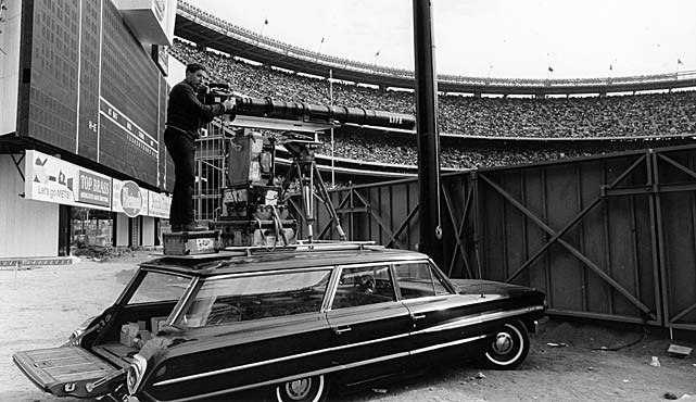 Fifty years ago -- in 1964 -- this setup at Shea Stadium was one of the many ingenious ways 22-year-old photographer Neil Leifer was taking award-winning shots for SI and Life magazines. What follows are 50 of the images he captured during that sports year -- including assignments at the Summer Olympics in Tokyo and Cassius Clay-Sonny Liston in Miami.