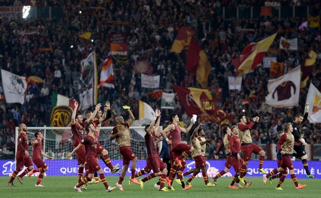 Roma players celebrate at Stadio Olimpico following a 2-0 triumph over AC Milan on Friday.