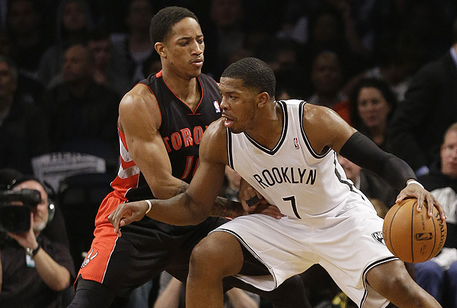 DeMar DeRozan (left) struggled to keep Joe Johnson (right) from getting to his spots in Game 3.