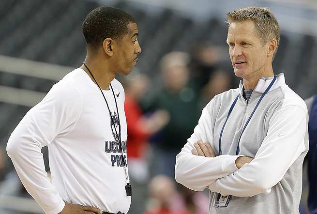 Was Steve Kerr (right) getting coaching advice from Kevin Ollie, or info for the game broadcast?