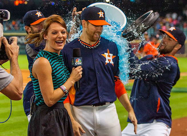 An unsuspecting Collin McHugh receives a Gatorade shower after holding the A's to two hits in 8 2/3 innings.