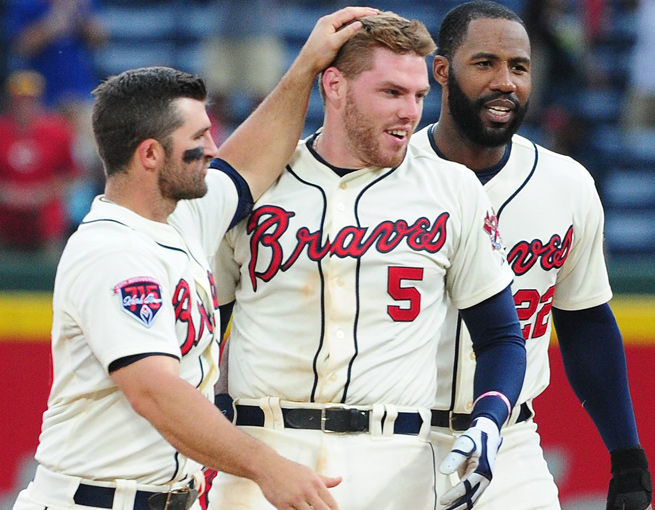 A walk-off hit by Freddie Freeman (center) on Sunday gave Atlanta its 12th win in 15 games.