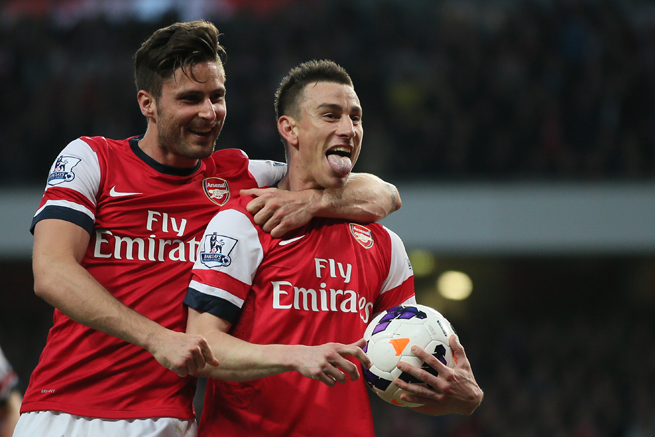 Arsenal's Laurent Koscielny, right, celebrates his goal with teammate Olivier Giroud in the club's 3-0 win over Newcastle on Monday.