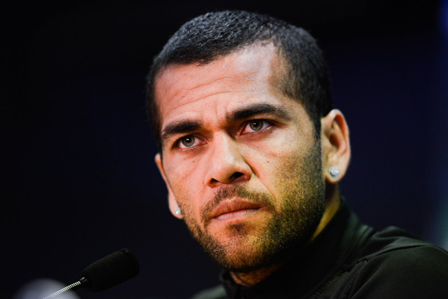 Barcelona's Dani Alves was the target of racial abuse in a match against Villarreal, which was fined for the incident.