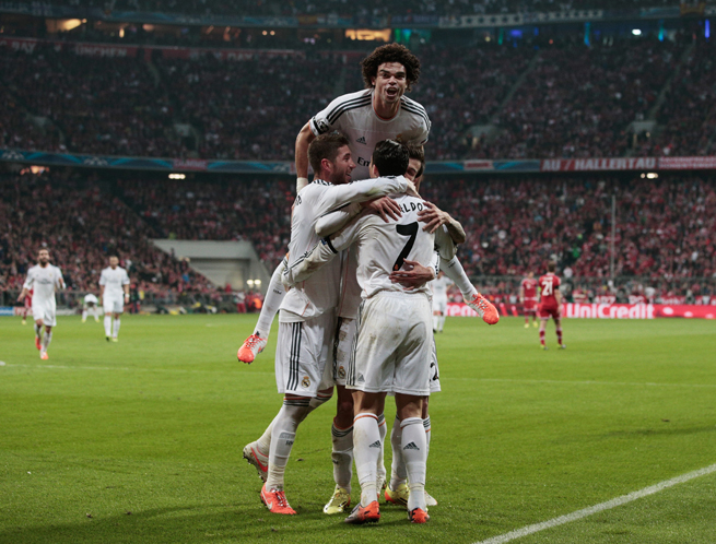 Cristiano Ronaldo (7) gets congratulated by teammates, including a leaping Pepe, after scoring in Real Madrid's 4-0 rout of Bayern Munich in the Champions League on Tuesday.
