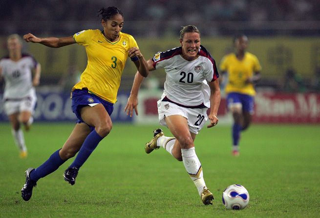 Aline Pellegrino, left, goes up against U.S. star Abby Wambach in Brazil's famous 4-0 win over the Americans in the semifinals of the 2007 Women's World Cup.