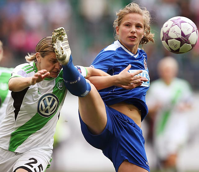 Tabea Kemme, right, of Potsdam and Martina Mueller of Wolfsburg jockey for the ball during the second leg of the UEFA Women's Champions League semifinals.