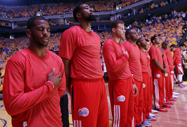 Warmup jerseys inside out, the Los Angeles Clippers listen to the national anthem before Game 4 of their quarterfinal series with the Golden State Warriors. The shirts served to protest racist remarks by team owner Donald Sterling.