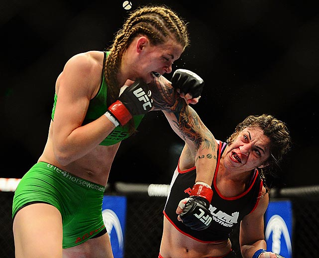 Bethe Correia lands a shot to the head of Jessamyn Duke at UFC 172.
