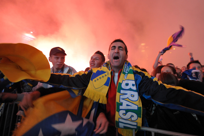 Fans, decked out in gear and emotion, flocked to a city square to watch a live broadcast of Bosnia-Herzegovina beating Lithuania 1-0 on Oct. 15, 2013, which resulted in qualification for this summer's World Cup in Brazil.