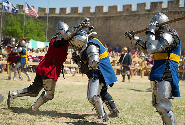 "Swedish and Polish (not Boogie) knights do battle at Spain's Belmonte Castle. According to the notes that came free with this photo, ""Medieval combat is a contact sport (<italics>we'll say!</italics>) based on medieval tournaments (<italics>makes sense</italics>) in Europe during the 14th and 15th centuries."" Tough stuff to be sure, but it can't hold a flanged mace to the NHL playoffs."