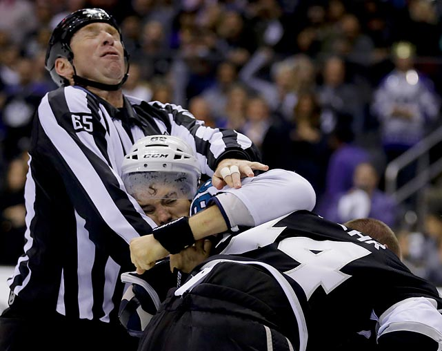 Now <italics>that's </italics>a contact sport! Linesman Pierre Racicot got in on a fracas between Los Angeles Kings defenseman Robyn Regehr (right) and San Jose Sharks winger Brent Burns during their first-round playoff series. Here's a closer (if you dare) look at your typical hockey combatants.
