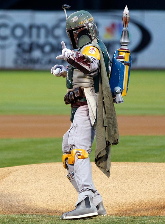 Boba Fett throws out the ceremonial first pitch before a game between the Oakland Athletics and Minnesota Twins at O.co Coliseum on Sept. 20, 2013 in Oakland, Calif.
