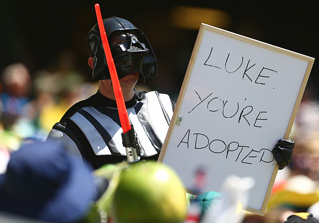 A member of the crowd dressed as Darth Vader holds up a sign during game four of the Commonwealth Bank One Day International Series between Australia and the West Indies at Sydney Cricket Ground on Feb. 8, 2013.