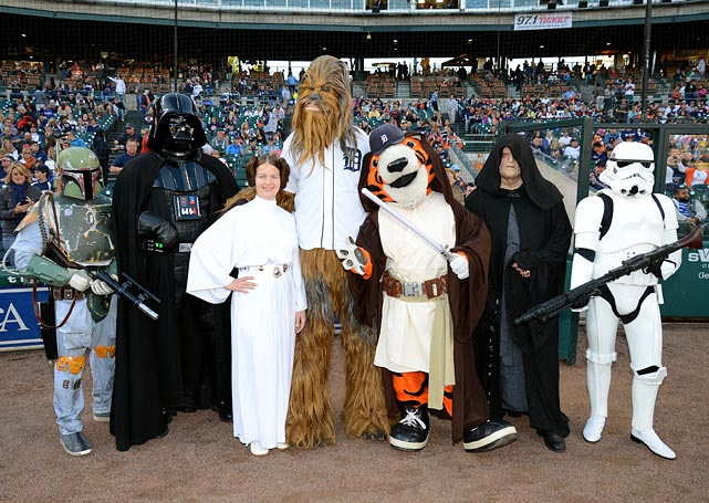"Detroit Tigers mascot Paws poses for a photo with Star Wars characters prior to the ""Star Wars Night"" game between the Tigers and Kansas City Royals at Comerica Park on Sept. 14, 2013 in Detroit."