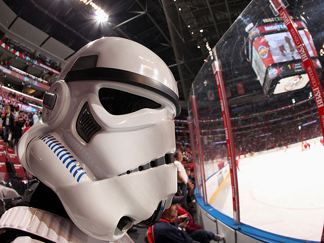 "A Stormtrooper looks on between periods of the Florida Panthers game against the Dallas Stars during ""Star Wars Night"" at the BB&T Center on April 6, 2014 in Sunrise, Fla."