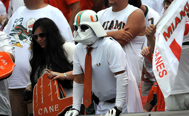 A University of Miami fan wears a white Darth Vader mask during the Hurricanes game against the Florida Gators at Sun Life Stadium in Miami on Sept. 7, 2013.