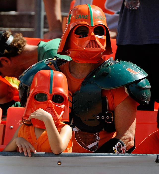 A University of Miami fan and his daughter wear Darth Vader masks painted in UM colors during the Hurricanes game against the Wake Forest Demon Deacons at Sun Life Stadium in Miami on Oct. 26, 2013.