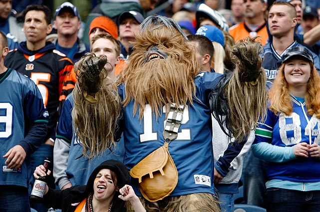 A Seattle Seahawks fan dressed as Chewbacca dances during the Seahawks game against the Cincinnati Bengals on Oct. 30, 2011 at Century Link Field in Seattle.