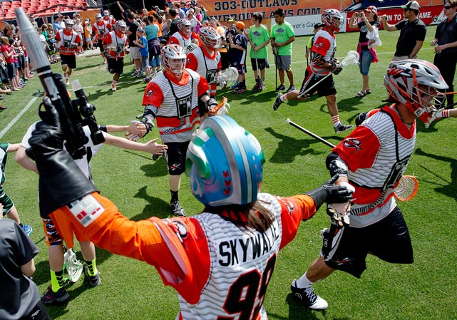 "The Denver Outlaws take the field in Rebel Alliance uniforms for their Major League Lacrosse game against the Ohio Machine at Sports Authority Field at Mile High on May 4, 2014 in Denver. <italics>May the 4th is something of a holiday in the Star Wars fan community ? ""May the fourth be with you,"" as the joke goes. Here are some photos of Star Wars characters and fandom appearing in sports over the years.</italics>"