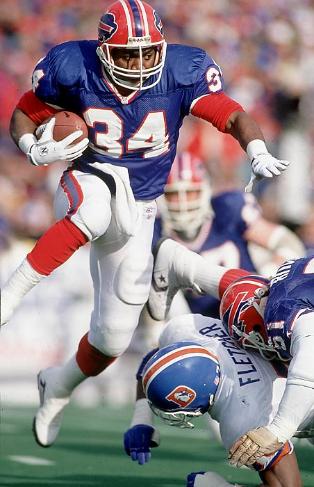 Thanks to a serious knee injury he suffered at Oklahoma State, Thomas slipped to the Bills in the second round. He energized Buffalo's offense and helped form a nucleus that carried the Bills to four straight Super Bowls. He retired in 2001, ranking sixth all time in total yards from scrimmage (16,532) and ninth in rushing (12,074). Thomas said the anger he felt at being bypassed in the first round was a motivating factor in his rise to stardom.