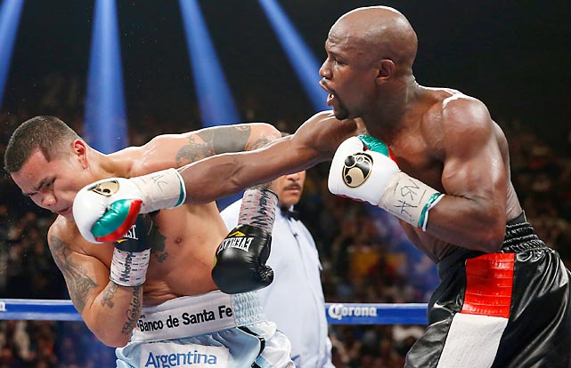 Floyd Mayweather Jr. lands a right on the chin of Marcos Maidana in their WBC-WBA welterweight title fight in Las Vegas.