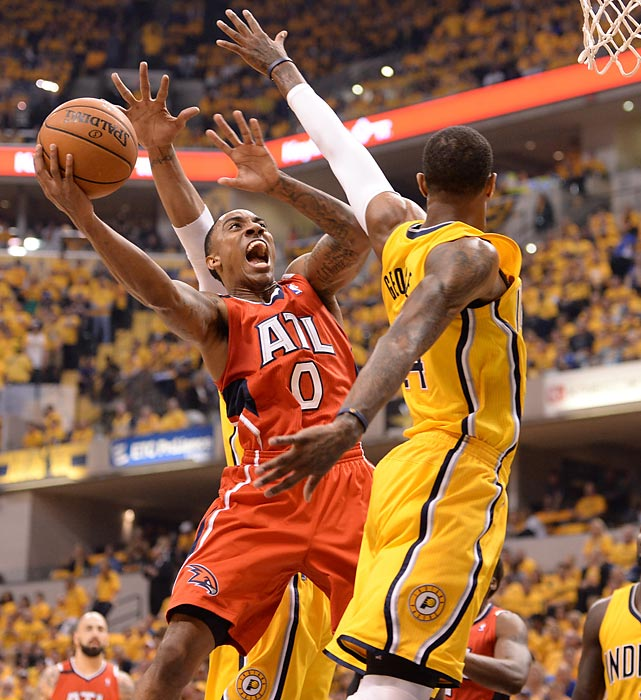 Atlanta's Jeff Teague puts up a shot against Paul George of the Indiana Pacers during Game 7 of their first-round series.