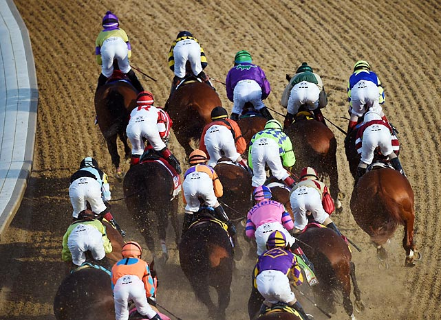 The Kentucky Derby pack fights for position.