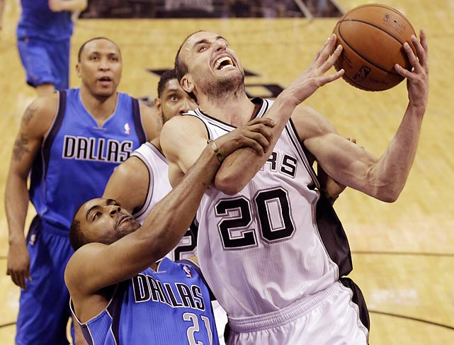 San Antonio Spurs guard Manu Ginobili draws a foul from Wayne Ellington of the Dallas Mavericks during Game 7 of their opening-round playoff series.
