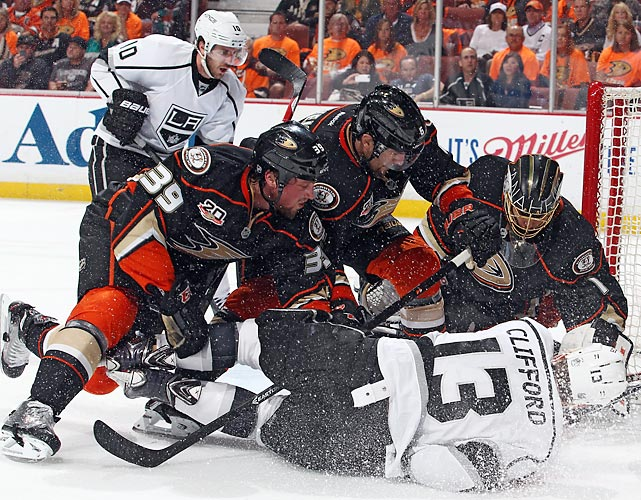 Matt Beleskey (39) of the Anaheim Ducks and Kyle Clifford of the Los Angeles Kings fight for the puck in front of goal in Game 1 of the second round of the Stanley Cup playoffs.