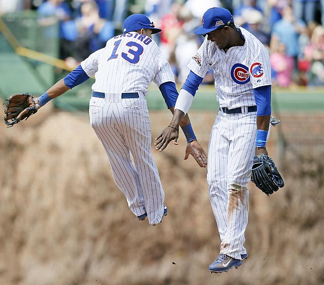 Starlin Castro, left, and Junior Lake celebrate after the Chicago Cubs defeated the St. Louis Cardinals 3-0.