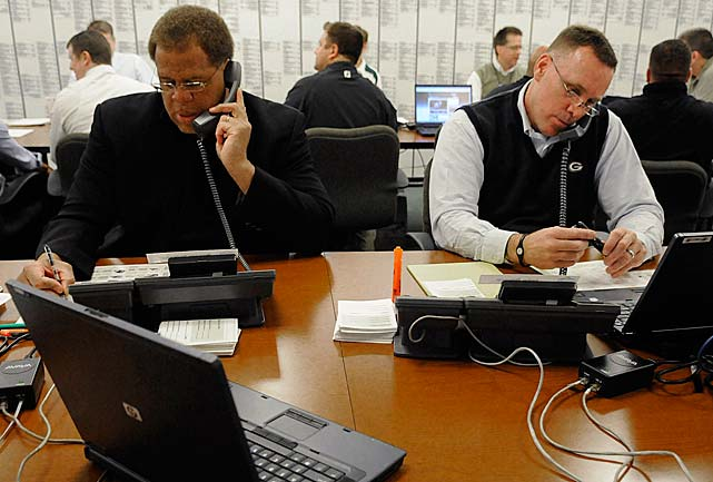 Green Bay Packers director of football operations Reggie McKenzie, left, and director of college scouting John Dorsey work the phones at Lambeau Field in 2010.