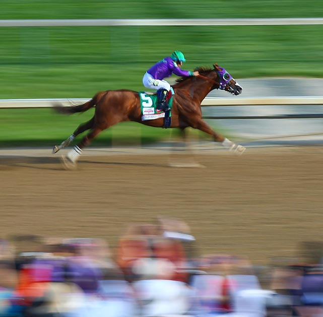 California Chrome and jockey Victor Espinoza pull away.