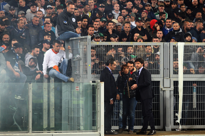 Napoli ultras leader Gennaro De Tommaso, perched on the railing, has been given a five-year stadium ban for inciting violence at Saturday's Coppa Italia final.