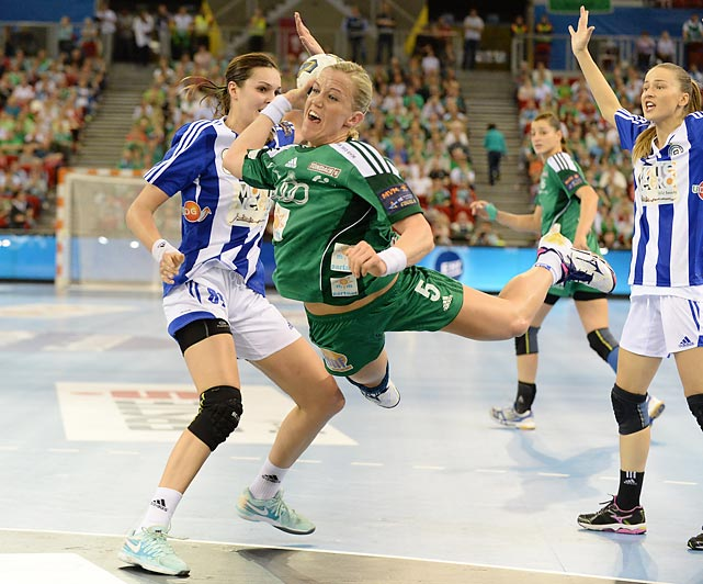 Hungary's Heidi Loke (5) shoots against Kinga Byzdra (89) of Montenegro's RK Buducnost in the final game.