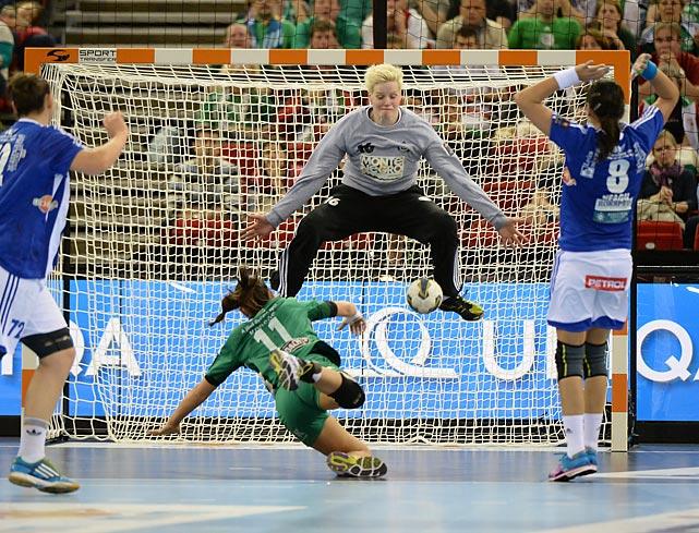 Dorina Korsos (11) of Gyori Audi ETO KC scores on goalkeeper Clara Woltering of Montenegro's RK Buducnost. Gyori won 27-21 to capture cthe championship.