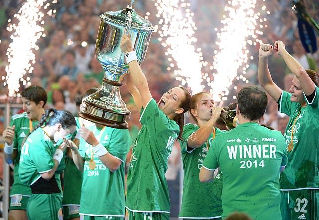 Anita Gorbicz of Gyori Audi ETO KC hoists the Champions League trophy.