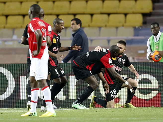Guingamp players celebrate Fatih Atik's late goal that salvaged a 1-1 draw against Monaco on Wednesday.