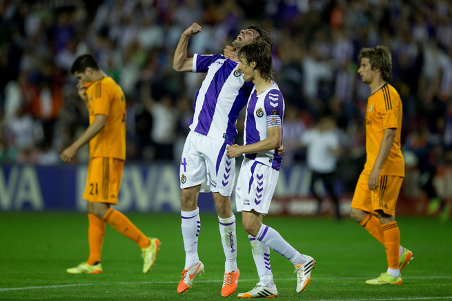 Real Valladolid's Marc Valiente, center left, and Alvaro Rubio celebrate the club's draw with Real Madrid on Wednesday.