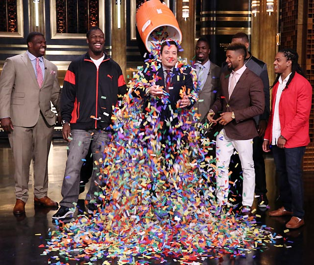 NFL draft prospects Greg Robinson, Jadeveon Clowney, C.J. Mosley, Odell Beckham Jr. and Jason Verrett shower Tonight Show host Jimmy Fallon with confetti on May 7.