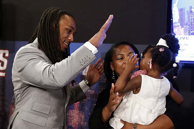 Calvin Pryor, from Louisville, high-fives with his 2-year-old daughter Jayle Exum and mother Monique Turrell after being selected 18th overall by the New York Jets.