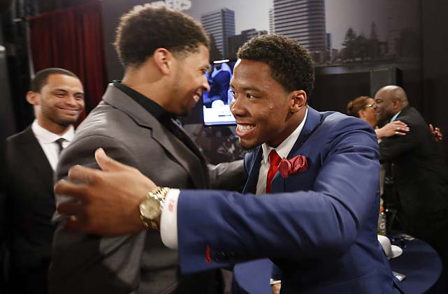 Kyle Fuller, right, from Virginia Tech, is congratulated after being selected 14th overall by the Chicago Bears.