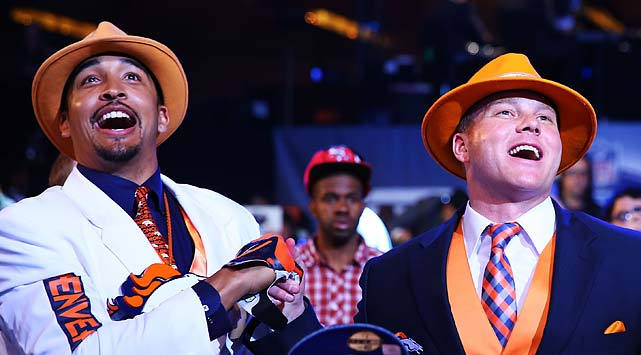 Denver Broncos fans react during the first round of the draft.