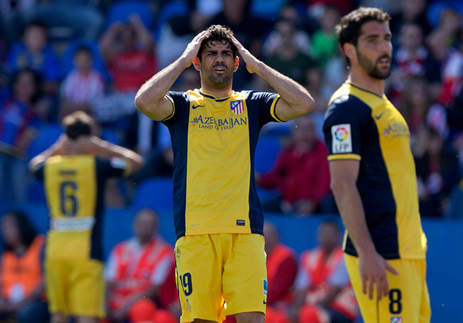 Atletico Madrid star Diego Costa, center, could miss the club's match against Malaga this weekend, which comes in the thick of the Spanish league title race.
