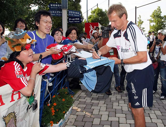 Klinsmann signs autographs for Japanese fans at a practice session in July 2008, having recently accepted the manager job at legendary German club Bayern Munich.