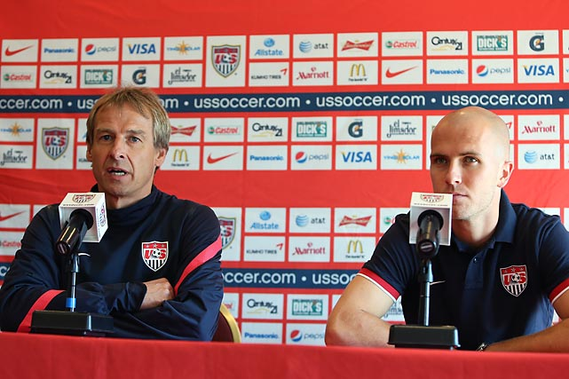U.S. midfielder Michael Bradley (right) and Klinsmann address the media in 2012. Klinsmann replaced Bradley's father, Bob, as U.S. coach in 2011, intending to create a distinctly American style of play.