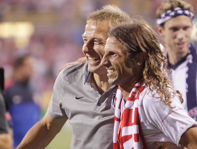 Former U.S. player Frankie Hejduk congratulates Klinsmann after the U.S. clinched a World Cup berth by defeating Mexico.